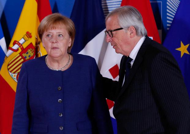 Merkel und EU-Kommissionspräsident Jean-Claude Juncker.