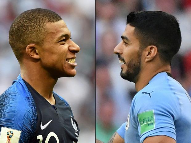 Duell der Stürmerstars: Frankreichs Mbappe (l.) gegen Uruguays Suarez.