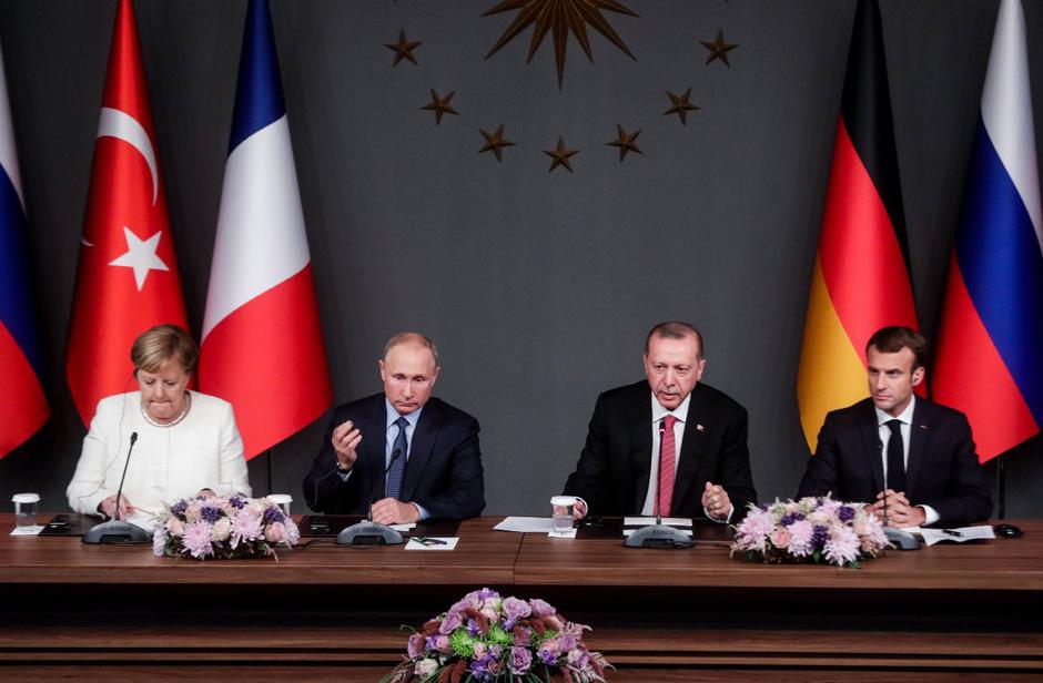 Die deutsche Kanzlerin Angela Merkel, der russische Präsident Wladimir Putin, der französische Präsident Emmanuel Macron und der türkische Präsident Recep Tayyip Erdogan.