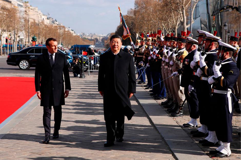 Präsident Emmanuel Macron (li.) und sein chinesischer Amtskollege  Xi Jinping.