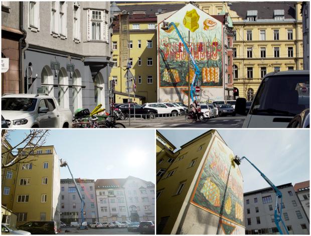 20 Meter über dem Boden: Der Hubsteiger ist für den erfahrenen Street-Art-Künstler längst keine Herausforderung mehr.