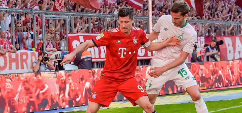 Die Bayern mit Lewandowski (rot) hatten beim 1:0-Sieg gegen Werder Bremen Mühe.