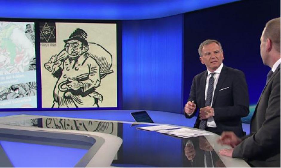 ZiB2-Moderator Armin Wolf hatte das Sujet des RFJ-Plakats einer Darstellung in einem NS-Blatt gegenüber gestellt.