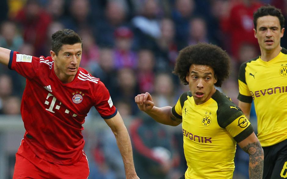 Robert Lewandowski (l.) und seine Bayern haben es in eigener Hand, Axel Witsel und der BVB müssen auf einen Umfaller der Münchner hoffen und selbst gewinnen.