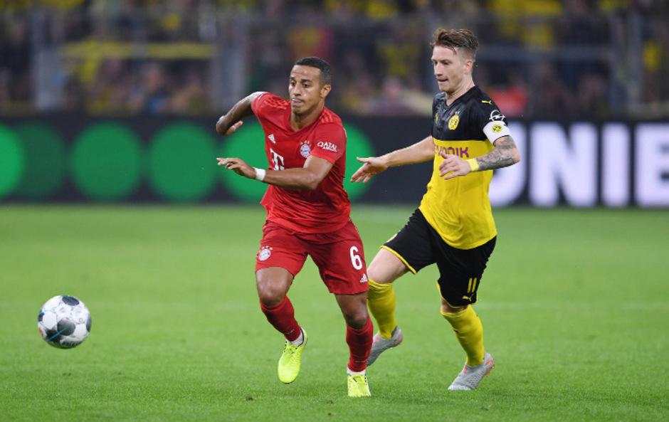 Im Supercup vor zwei Wochen behielt der BVB mit Marco Reus (r.) die Oberhand gegen die Bayern (Thiago Alcantara).