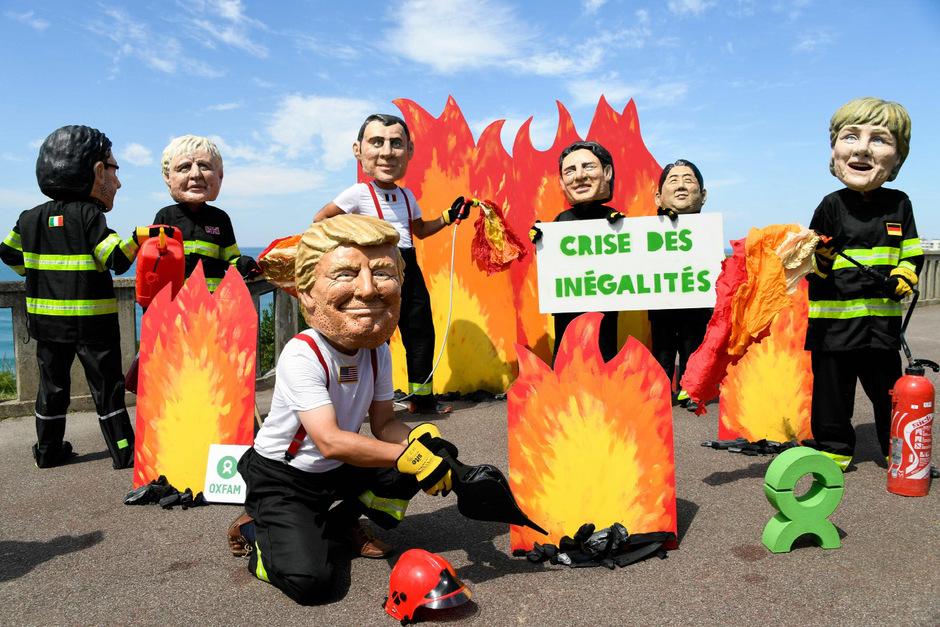 Oxfam-Aktivisten prangern im Vorfeld des G7-Gipfels eine Krise der Ungleichheit an.