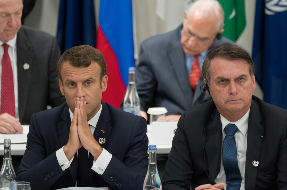 Brasiliens Präsident Jair Bolsonaro (r.) neben dem französischen Staatsoberhaupt Emmanuel Macron im Juni dieses Jahres.